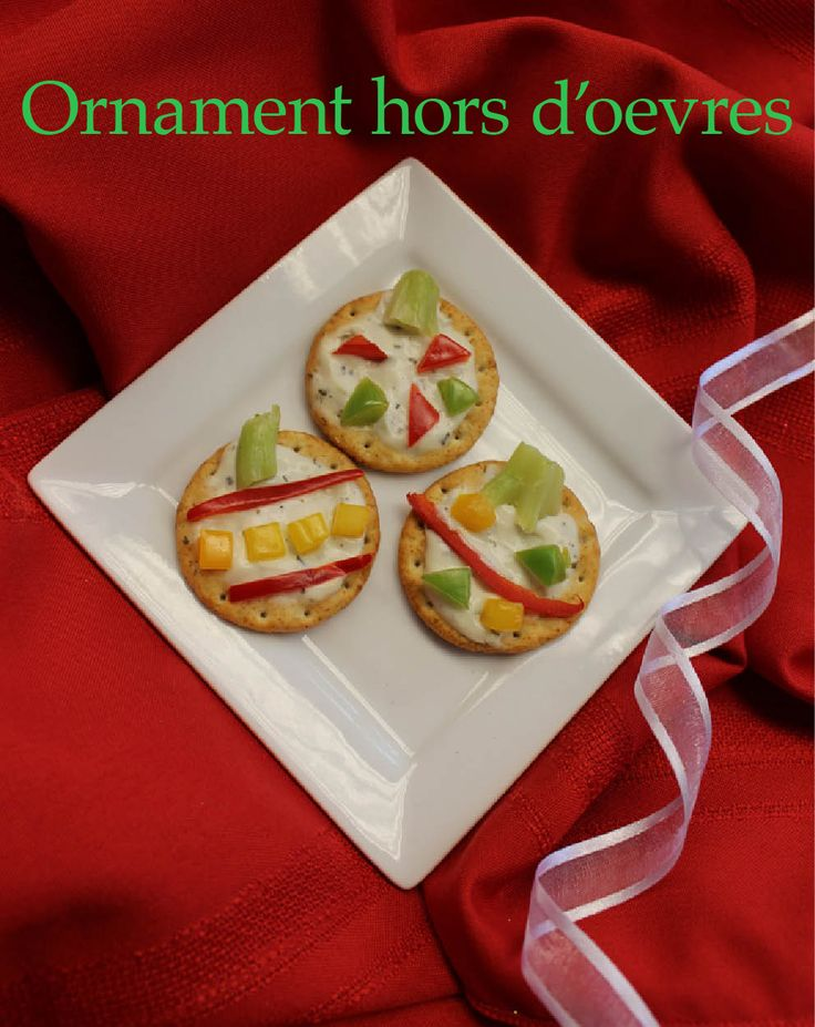 Getting bored of the same old crackers and dip? Impress your guests with these simple crackers coated in healthy Greek yogurt based veggie dip and chopped veggies. They're easy, delicious, and look like Christmas ornaments!