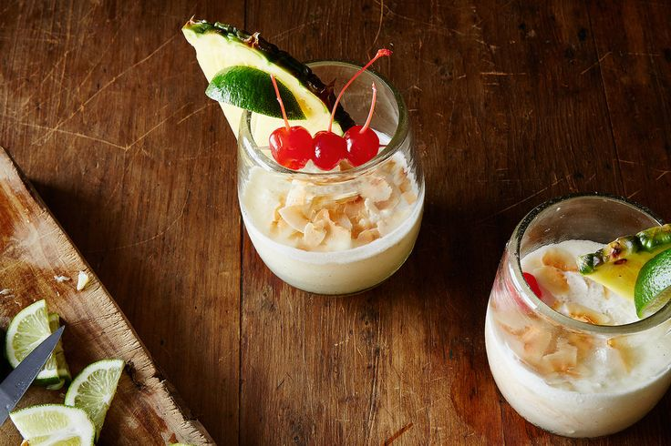 Frozen Piña Colada -  White Rum, Cream of Coconut, Pineapple Juice, Lime Juice, Ice, Pineapple, Cherries and Shaved Toasted Coconut for Garnish.