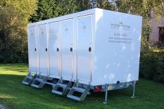 The outside view of a brand new luxury mobile shower unit from Mobile Thrones.  Perfect for your party, wedding or event!