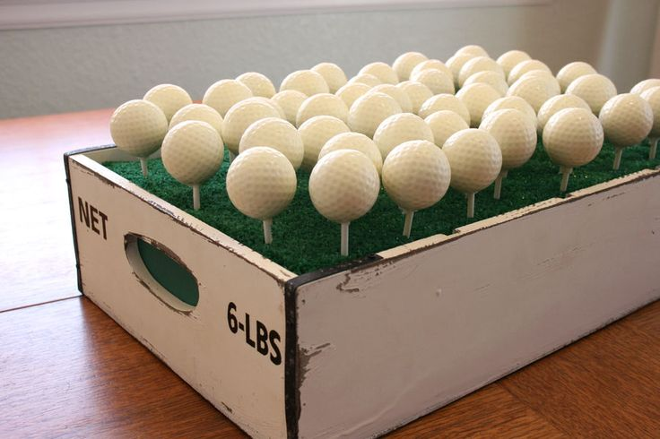 These might be a pain to make or expensive to get but a cute idea if we had a gold theme.   Golf ball cake pops