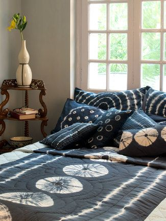 Drape this beautiful tie and dye quilt across a wide wooden bed to create a serene contemporary look to your bed room.