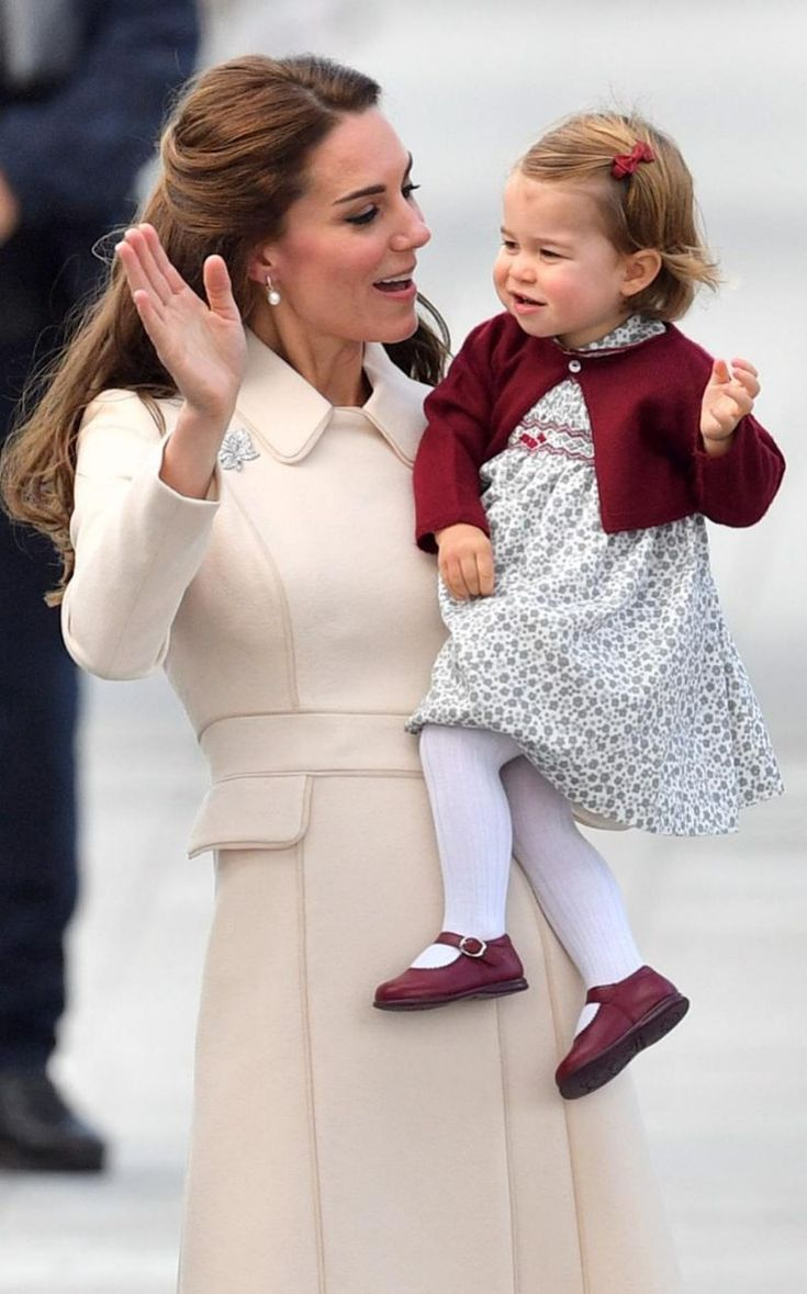 Catherine, Duchess of Cambridge and Princess Charlotte wave as they leave from Victoria Harbour to board a sea-plane on the final day of their Royal Tour of Canada on October 1, 2016 in Victoria, Canada.