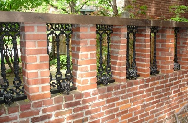 Like any outdoor bricks, the main issue with maintaining a brick fence is controlling the proliferation of mildew and moss. Use a bleach solution and a scrubber to thoroughly scour the length of the fence.