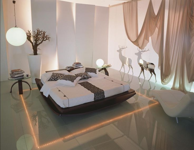 http://www.drissimm.com/wp-content/uploads/2015/07/cool-exotic-bedroom-decorating-ideas-in-modern-house-with-different-wall-also-white-bedding-and-led-lighting-on-floor-beside-bed-plus-white-lounge-chair.jpg