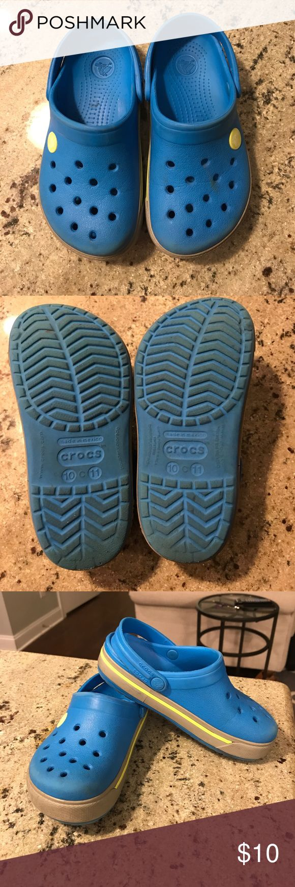 Crocs Bright blue crocs with a grey and lime green striped sole. These are the perfect fit for your little one who likes getting dirty. They wash right off and can be thrown in the washer any time. They have the strap that can be worn on heel for security or flipped up for ease of slipping on and off. Size C 10/11 CROCS Shoes Sandals & Flip Flops