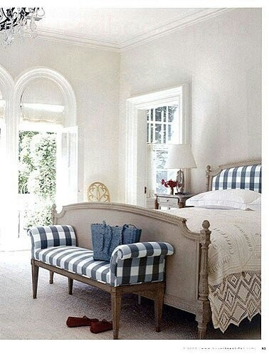 blue and white bedroom. gingham. pattern on headboard and bench.