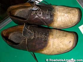 """Shoes Made From The Skin Of Big Nose George Parrott. George Francis Warden, a.k.a. """"Big Nose George Parrott"""" was a horse thief and a train robber. In 1878, after a botched hold-up, he and his gang killed a couple of lawmen and fled to Montana. """"If he'd kept his big mouth shut he wouldn't of got caught,"""" said Ilene Hanson, an assistant at the museum. """"But he got to bragging."""" He was lynched and had his chest and thighs skinned and made into a doctor's bag, a coin purse and a pair of shoes."""