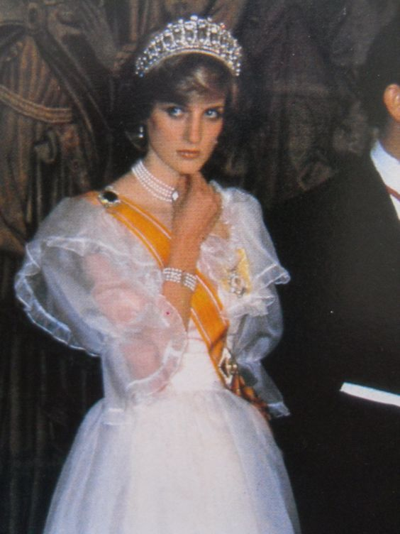 November 18, 1982: Princess Diana attends a banquet at Hampton Court Palace for Queen Beatrix of the Netherlands.