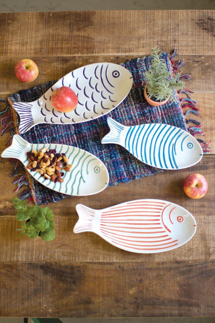 "This school of ceramic fish platters features four colorful fish, each with their own pattern and color. Use these guys as serving trays at your next dinner party for a splash of tropical fun and convenience. large 14½"" x 6½"""