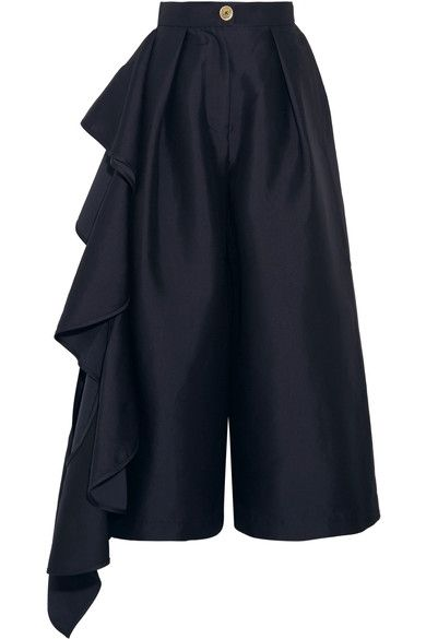 """Our design aesthetic and core values are based around timeless modernity and futurism, with fabrication and technique driving design,"" says Solace London. These 'Margo' culottes are made from crisp navy charmeuse and sit high on the waist to balance the volume. A cascade of ruffles trail down one side to reach your foot."
