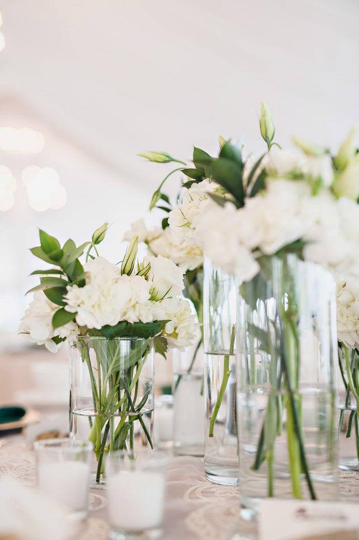 Elegant, rustic, romantic centerpieces with cream florals and lush greens . Black tie summer wedding . Meadowbrook Hall . Kari Dawson Photography