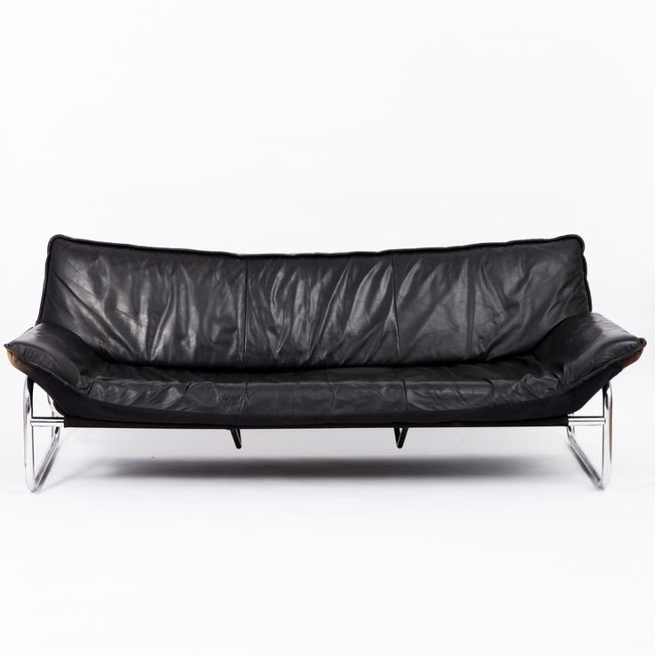 Circa 1970    This extremely elegant and comfortable gondola sofa in style of Gae Aulenti features its original, vintage cushions in black leather and is resting on a sturdy, chromed steel frame.
