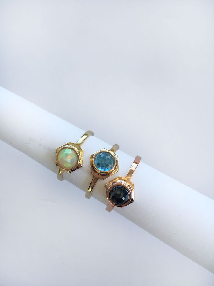 Single Hex rings in 10k yellow and rose gold. 6mm rose cut Ethiopian Opal, Swiss Blue Topaz, and Black Spinel