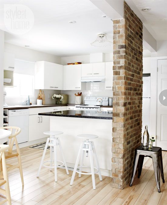 modern white kitchen, slice of brick