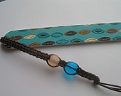 Macrame beaded bookmark and nailfile. $3.00, via Etsy.