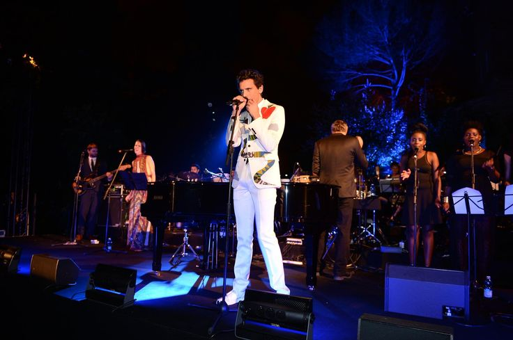 Mika and his mother attended Valentino's fashion show 'Mirabilia Romae' at the Piazza Mignanelli in Rome on July 9, 2015, along with many other famous people. At the end of the catwalk show an exclusive dinner took place at the Villa Aurelia with more than 700 guests, with a surprise performance by Mika with backing vocalist Ida Falk-Winland and an orchestra conducted by Simon Leclerc. Guests included many designers, models, and actors such as Gwyneth Paltrow, Ben Stiller and Tilda Swinton.