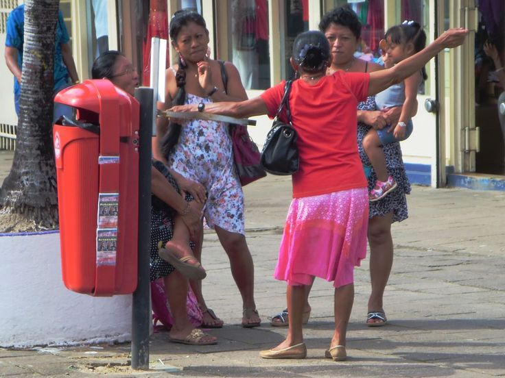 A group of women enjoy a lively discussion on a Paramaribo street. Around 15 percent of the current population of Suriname is of Javanese  origin.