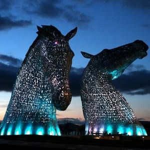 A new Scottish cultural landmark has been lit up for the first time, days before the public get a chance to take a closer look at the colossal structures.