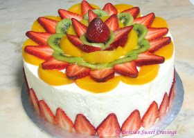 Light and moist vanilla chiffon cake, frosted with whipped cream and decorated with fresh fruits.