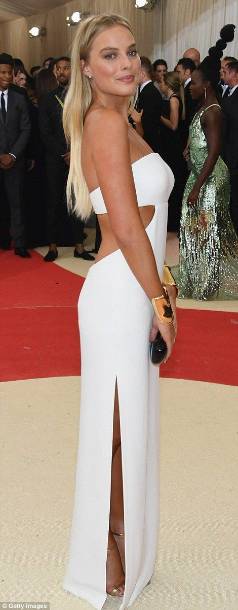 Angelic: Blonde beauty Margot Robbie looked gorgeous in a white Calvin Klein cut-out dress...