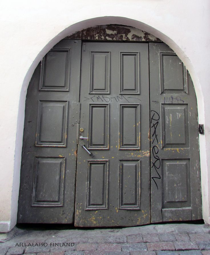 Old gray wooden gate in Tallinn Old Town, Estonia  by Aili Alaiso Finland