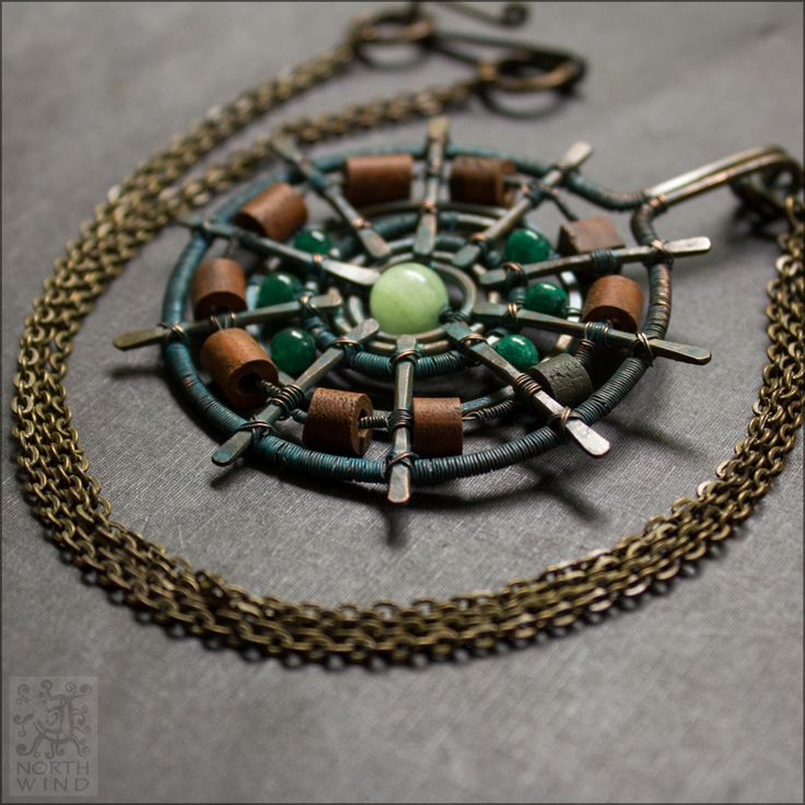 """""""Earth Magic""""  sun pendant.  Made of hand crafted ceramic beads, copper and natural stones."""