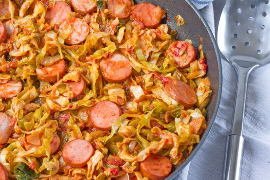 The cabbage is cooked down with tomatoes, seasonings and smoked sausage for a hearty and delicious meal-in-itself.