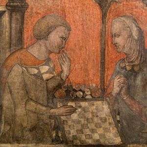 La moglie del duca Guernieri gioca a scacchi con il cavaliere Guglielmo e tenta di sedurlo. Affreschi in loco del ciclo della Castellana di Vergi, fine XIV secolo. Firenze, Museo di Palazzo Davanzati