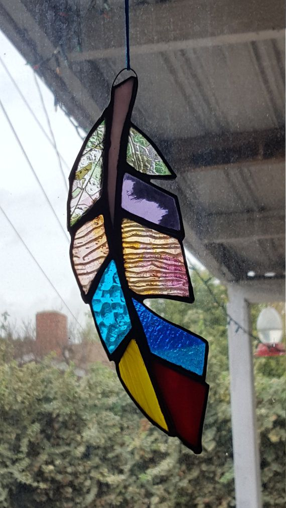 This is fully handcrafted unique stained glass feather suncatcher. It measures 3 x 7 1/2. Orders will be shipped within 3 business days. I made this piece using the Tiffany copper foil style, combining high quality, unique translucent glass. Custom Requests Welcome. FREE SHIPPING! ((( : )