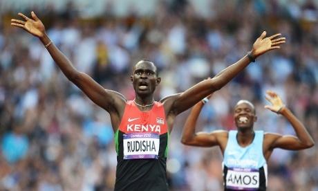 David Lekuta Rudisha of Kenya celebrates winning the men's 800m final ahead of Nijel Amos of Botswana who came second.