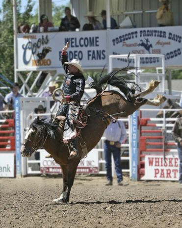 Bucking broncos at the Prescott Frontier Days and the World's Oldest Rodeo.