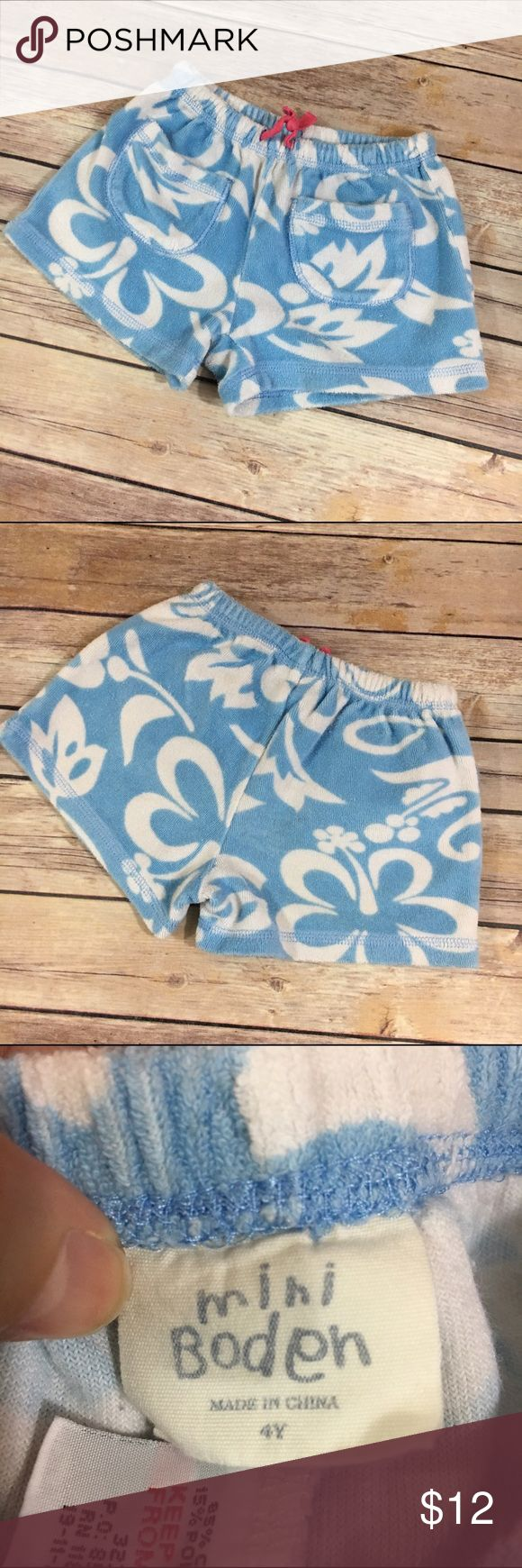 Mini Boden Blue White Hibiscus Terry Shorts 4 Mini Boden Blue White Hibiscus Terry Shorts 4  Very cute, play to good condition.  Wash wear.  Elastic waist.  These look to run small.  Pockets on front.  #terry #terrycloth #beachwear #tothebeach #letsgotothebeach #blue #white #flowers #hibiscus #hawaiian #shorts #shortstuff #summer Mini Boden Bottoms Shorts