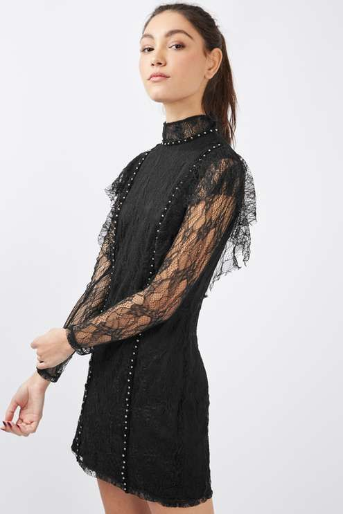 Opt for a slightly edgier look this party season in this little black dress with ruffle to the shoulders, sheer lace sleeves and studded detail to the bodice. Black ankle boots make a perfect pairing.. #Topshop