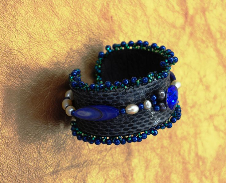 Snake skin and natural pearls Hand made couture cuff with elephant leather on the interior and mother pf pearl blue, oval beads.  SKYPE US NOW   RoyaleCoutureJewelry