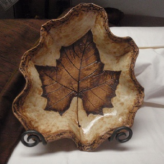Pottery made using an actual leaf pressed into the clay. Really cool because every leaf is so unique.