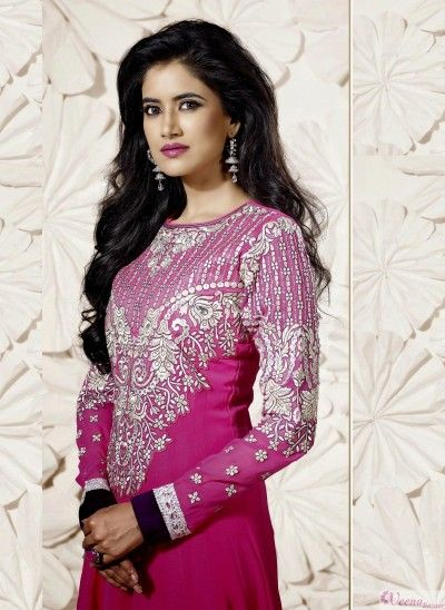 Glorious hot pink sequins work faux georgette anarkali suit with border work.pair with mathcing bottom and dupatta.