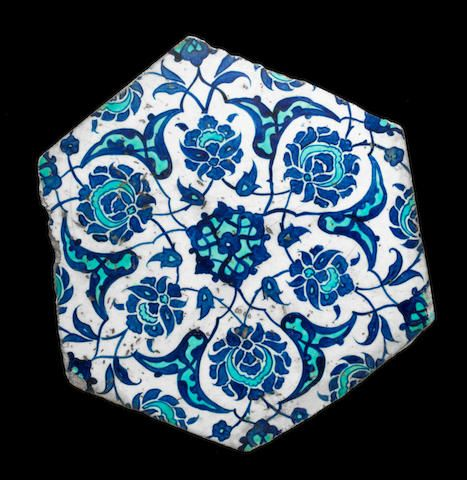 Iznik blue and white hexagonal pottery Tile Fragment Turkey, circa 1530 28.2 cm. max. diam.