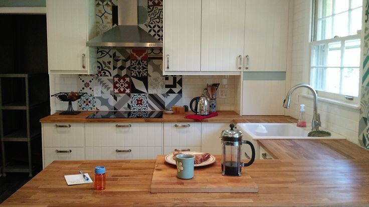 This IKEA farmhouse kitchen was inspired by a beautiful kitchen in Sicily with Mediterranean tile. HITTARP doors plus patchwork tile make the look.