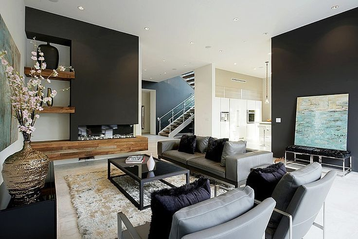 Living room with feature fireplace and shelving