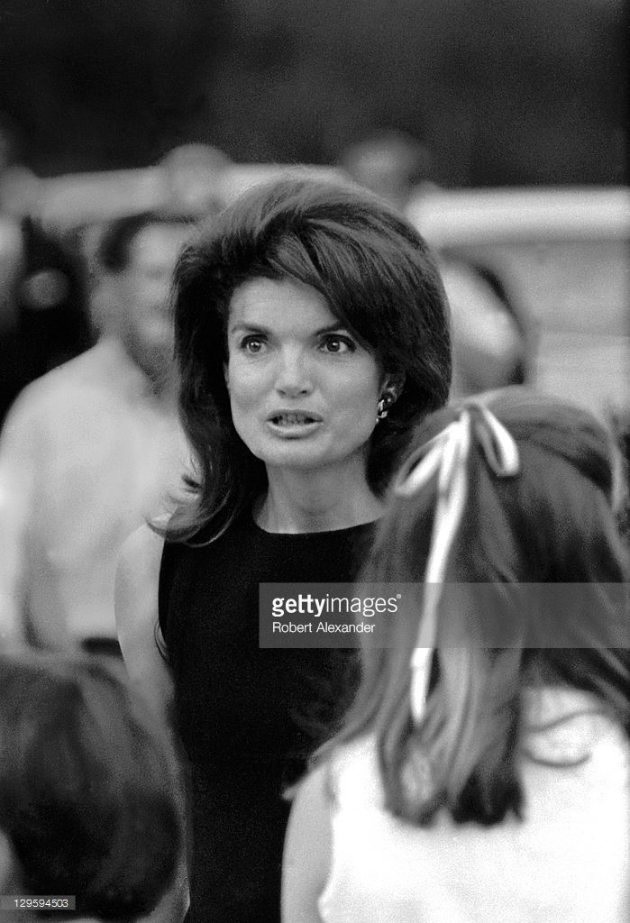 WASHINGTON D.C. - JUNE 6: Former First Lady Jackie Kennedy walks toward the grave sites of her husband, John Kennedy, and brother-in-law, Robert Kennedy, at Arlington National Cemetery on the first anniversary of the assassination of Robert Kennedy on June 6, 1969 in Washington D.C