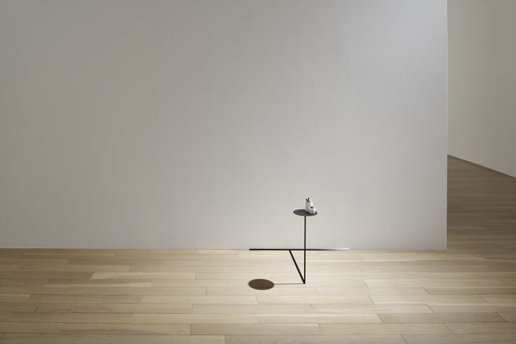 Each border table is constructed from square metal rods almost one-fifth an inch wide; they hold circular metal disks about 4 inches in radius.