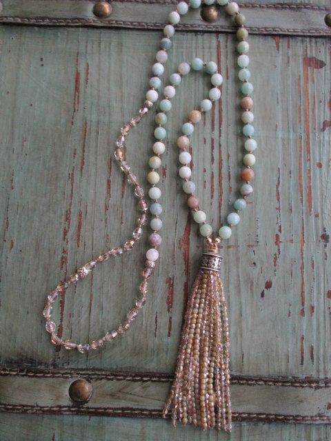 "Beachy tassel necklace Sea Sway knotted long semi by slashKnots- Hand-knotted faceted semi precious stones with Czech glass beads. Sterling and gold fill accents. A sparkly glass tassel gives a neutral, beach look. Looks great worn with gray. Measures 34 1/2"" with a 4 1/4 tassel drop. KDIA. BeadTassel"