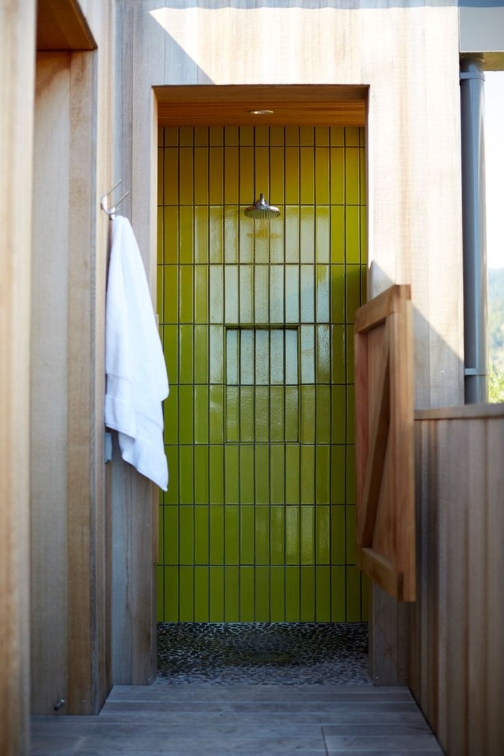 Bright lime green tile has been used in this outdoor shower.