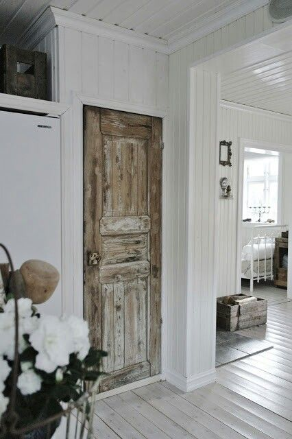Distressed door- barnwood - wonder if I could do this to my regular doors, add barnwood?