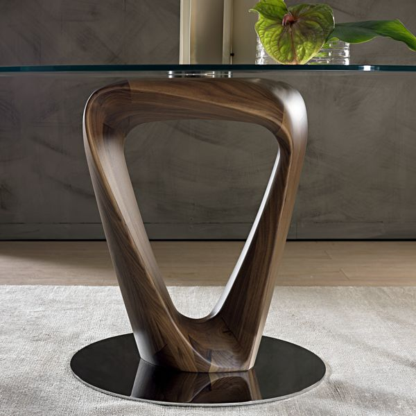 The luxurious Mobius dining table was designed by Stefano Bigi for Pacini e Cappellini. The glass surface sits atop a highly sculptural base in solid walnut or ash, and a round glass top