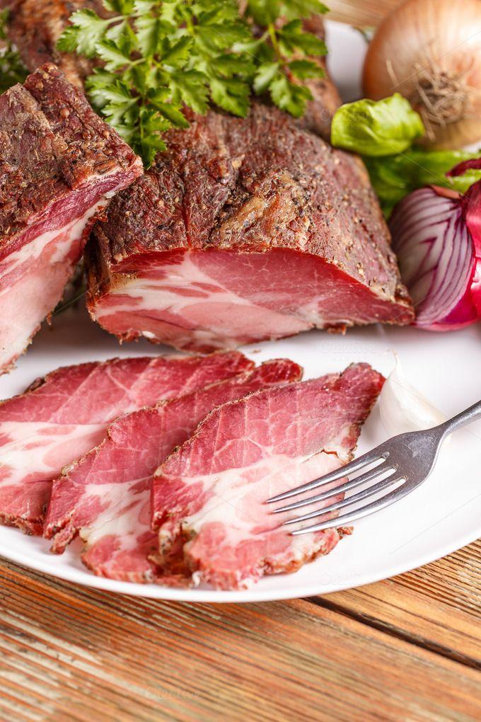 #Dry-cured ham slices  Dry-cured ham slices on white plate