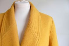 Lovely decorative stitching around the upper collar of this mustard yellow wool coat. (From LoveMissP's etsy page)