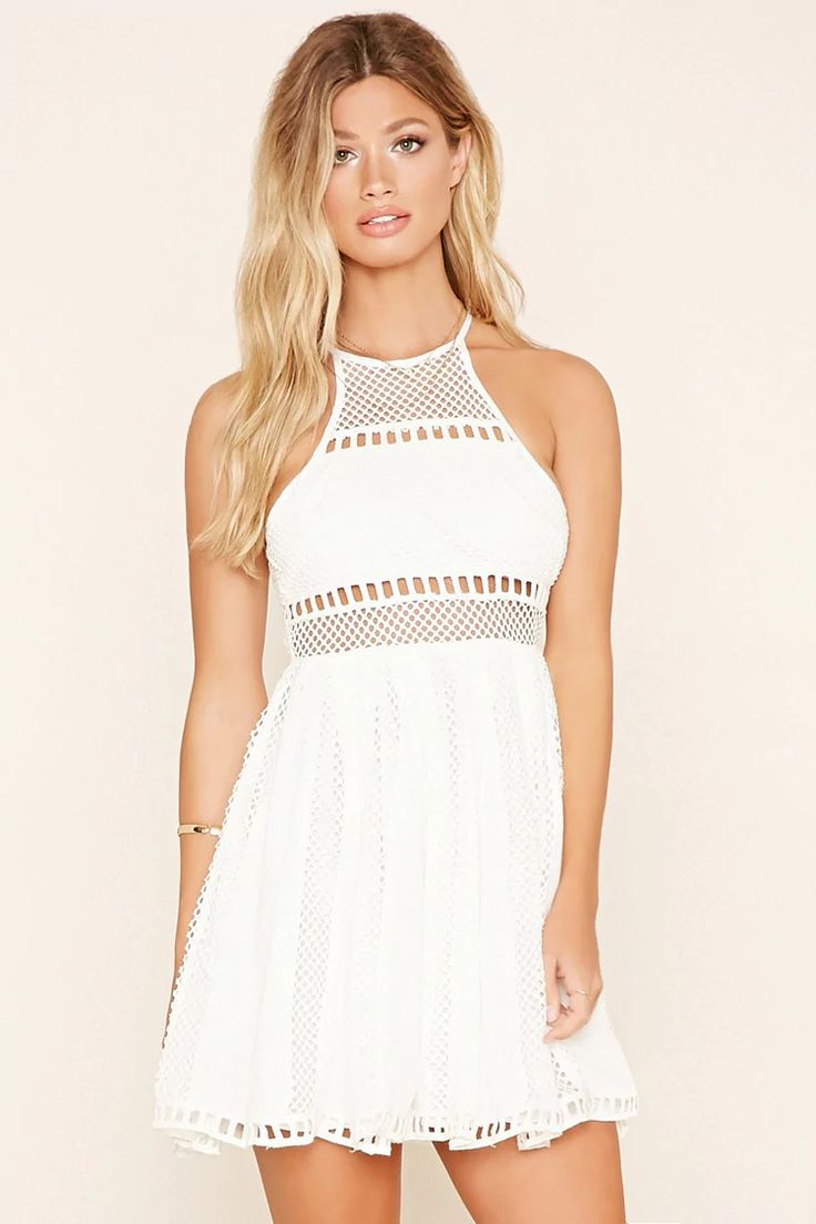 A mini cami dress from Selfie Leslie™ crafted from a semi-sheer knit crochet with laddered trim, a high neckline, a subtle Y-back, and an exposed back zipper.  #f21brandedshop