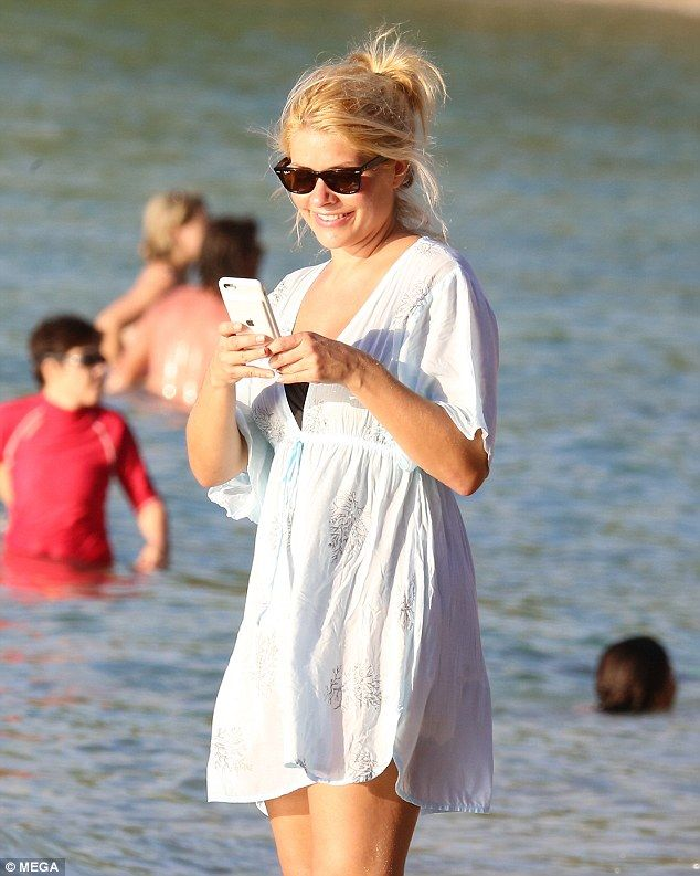 Making waves! Holly Willoughby enjoyed some well-deserved time off as she spent the last day of 2016 on the beach in Barbados with husband Daniel Baldwin and their children