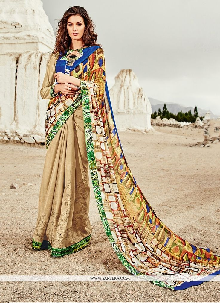 Be an angel and create and ascertain a smashing effect on everyone by wearing this multi colour georgette printed saree. The print work appears to be chic and great for any occasion. Comes with matchi...
